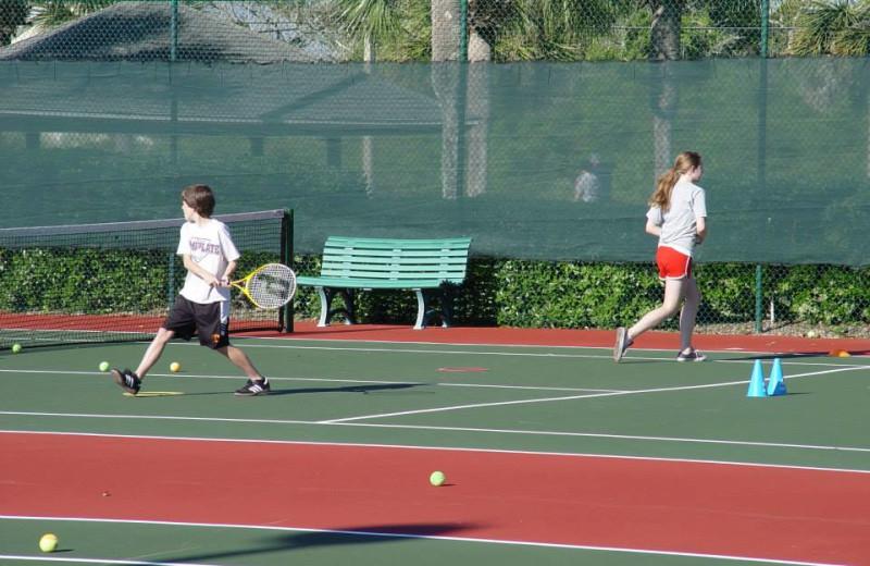 Playing tennis at St. Augustine Ocean & Racquet Resort.