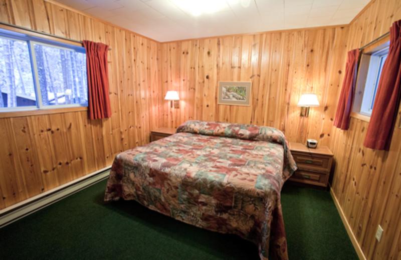 Cottage bedroom area at Blue Spruce Resort.