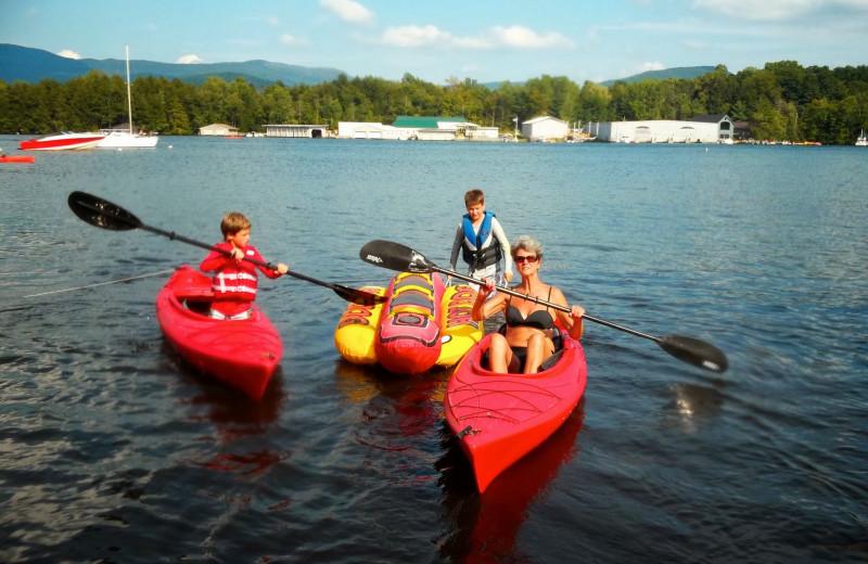 Family kayaking at Contessa Resort.