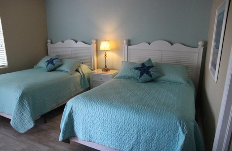 Guest bedroom at Olde Marco Inn & Suites.