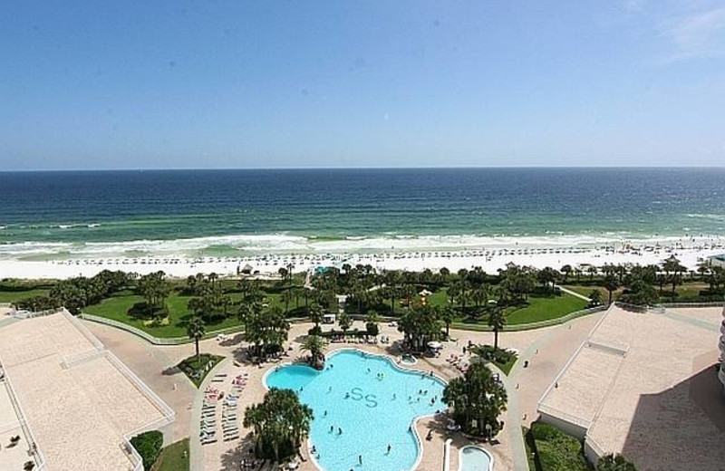 Outdoor pool and beach at Compass Resorts.