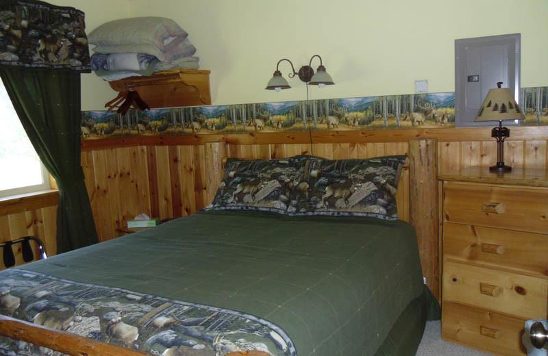 Cabin bedroom at Glaciers' Mountain Resort.