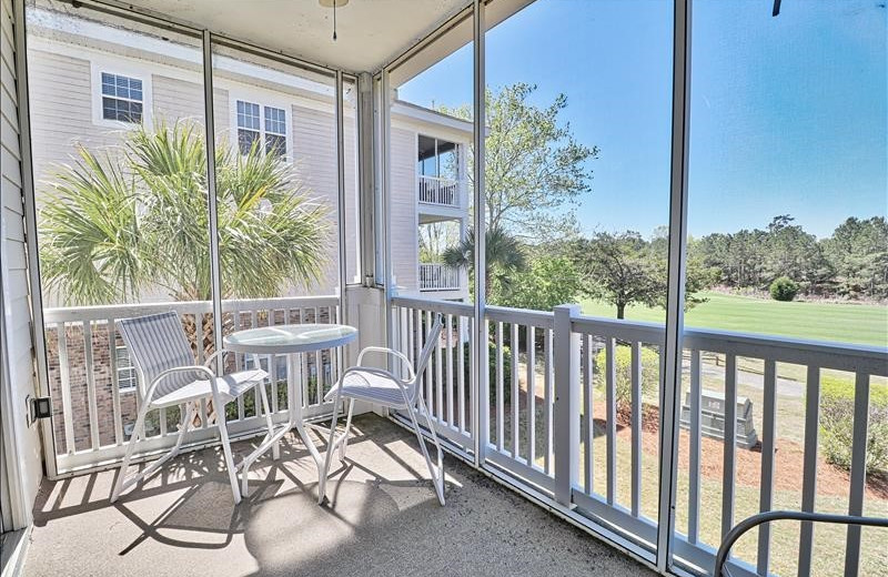 Rental balcony at Barefoot Resort Rentals.