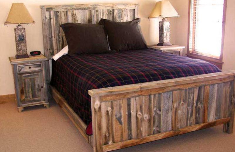 Cabin bedroom at Teton Springs Lodge.