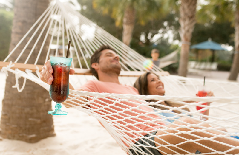 Couple relaxing in hammock at Holiday Inn Club Vacations at Orange Lake Resort.