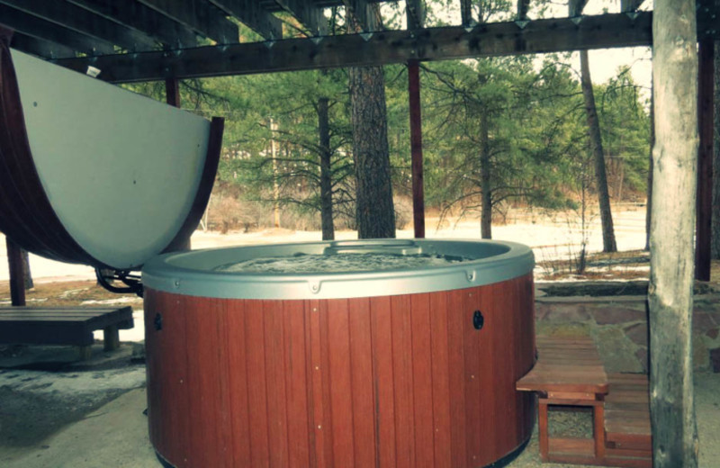 Cabin hot tub at Edelweiss Mountain Lodging.
