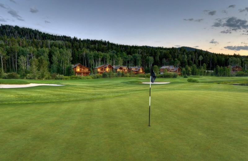 Exterior view with golf course at Teton Springs Lodge.