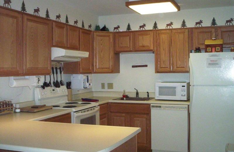 Guest kitchen at Discounted Condominium Rentals.