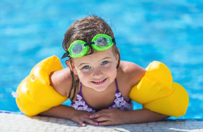 Kid in pool at The Quarters at Lake George.
