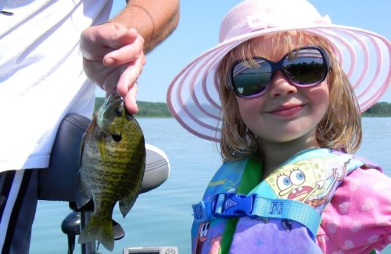 Kid With Fish at Janetski's Big Chetac Resort