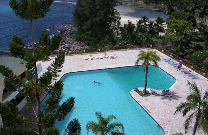 Outdoor pool and beach at Berjaya Mahe Beach Resort.