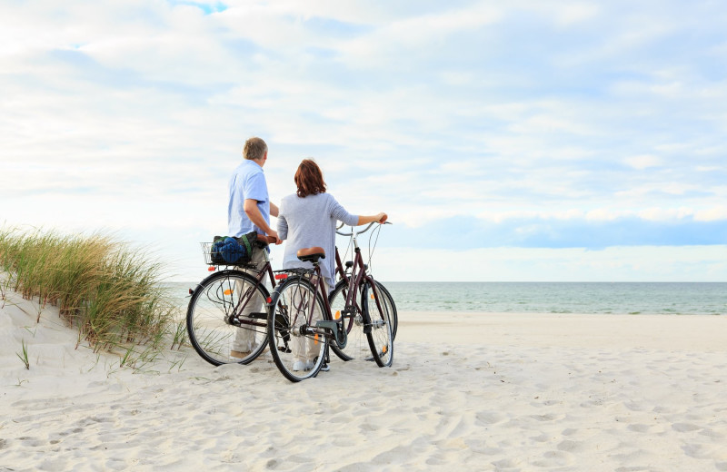 Couple on beach at Vacation Time of Hilton Head Island.