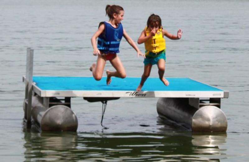 Kids Playing At The Lake at Janetski's Big Chetac Resort