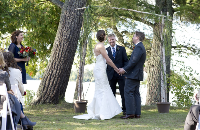 Wedding ceremony with branch arch at the Aurora cabin.