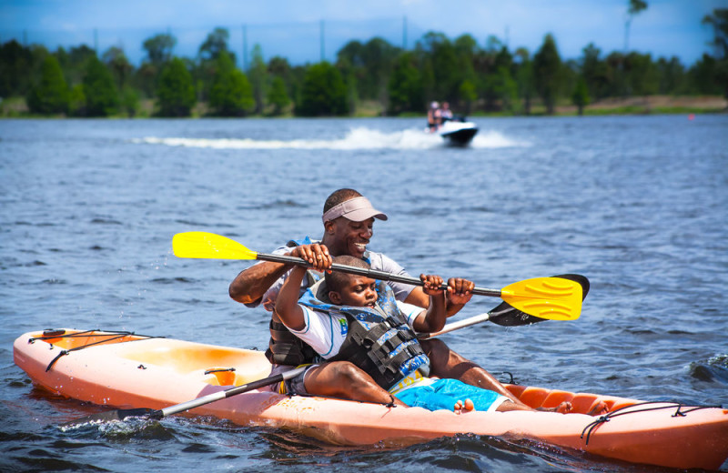 Family kayaking at Holiday Inn Club Vacations at Orange Lake Resort.