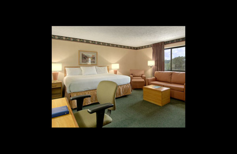 Guest room at Baymont InnSuites Traverse City.