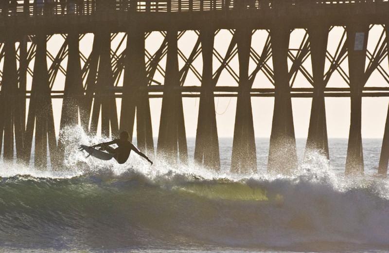 Surfing at the Oceanside Pier in Oceanside, California