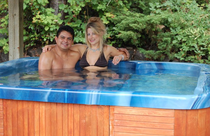 Couple in hot tub at Hood Canal Cottages.