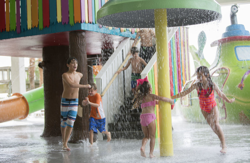 Kids playing in splash pad at Crown Reef Resort.