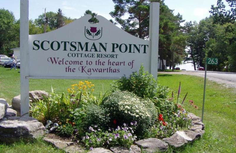 Welcome sign at Scotsman Point Cottage Resort.