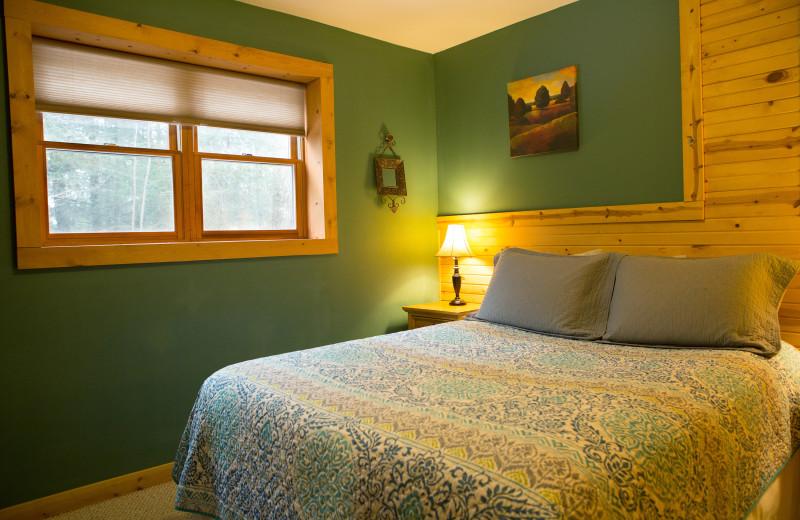 Cottage bedroom at Harvest Moon Cottages.