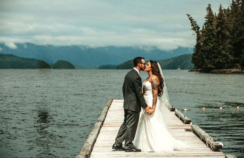 Couple on the dock at Salmon Falls resort for their wedding. Beautiful backdrop of the water.