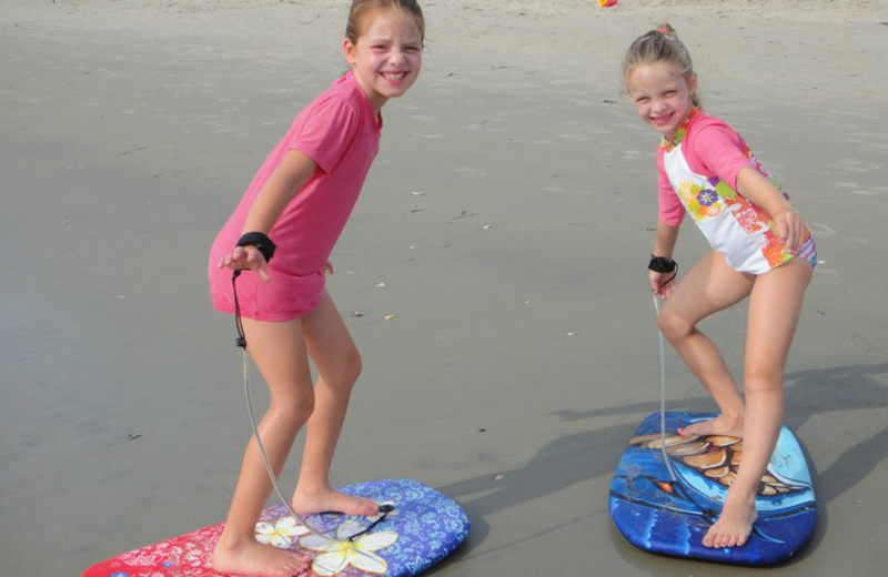 Kids at beach at Ramada Plaza.