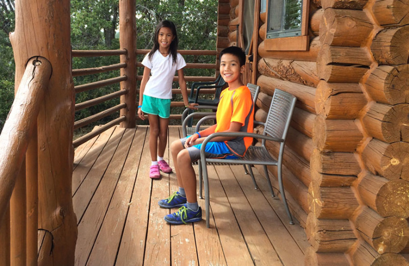 Cabin deck at Zion Ponderosa Ranch Resort.