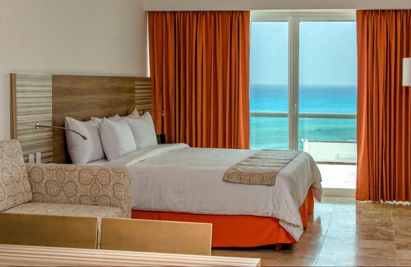 Guest room at Krystal Cancun Hotel.