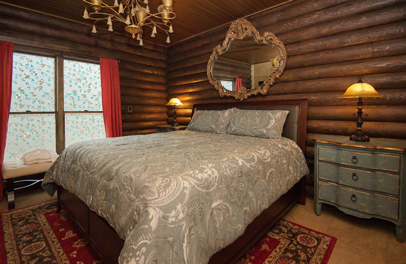 Cabin bedroom at Cut Above Cabins.