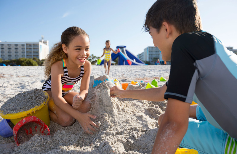 Kids playing in sand at TradeWinds Island Grand.