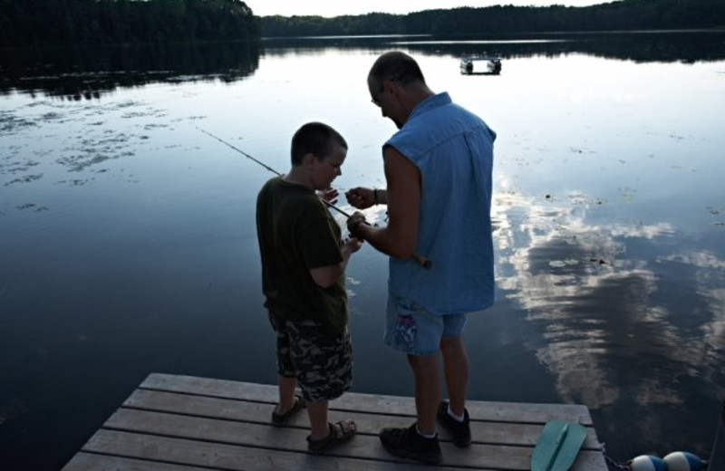 Fishing off the dock at Heartwood Conference Center & Retreat.