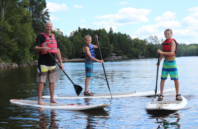 Paddle board at YMCA Camp Du Nord.