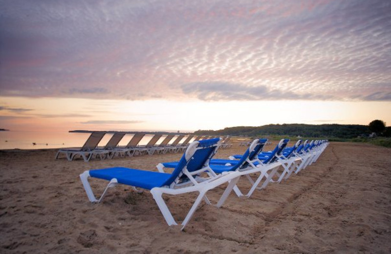 Lounge chairs on the beach at Tamarack Lodge.