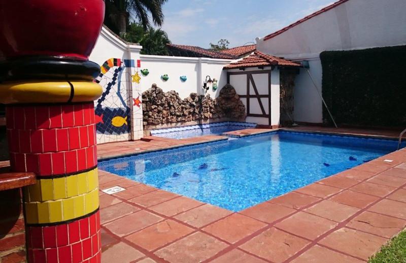 Outdoor pool at Apart-Hotel Porta Westfalica.