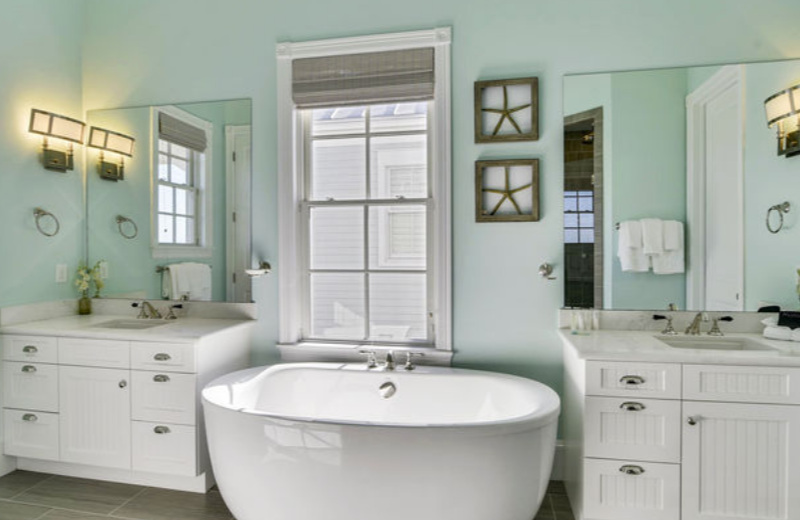 Ryson Vacation Rentals' home - dual vanity & deep soaking tub, perfect for couples or relaxing getaway.
