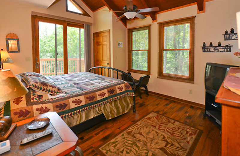Cabin bedroom at Black Bear Resort Rentals.