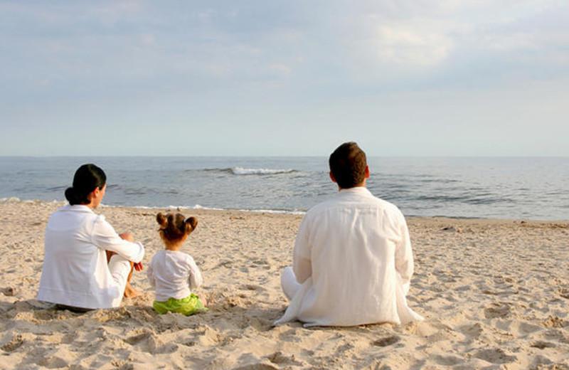 Family on beach at Ramada Plaza.