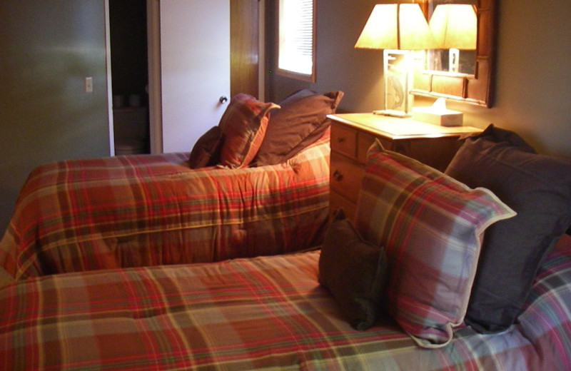 Guest beds at Teton Valley Lodge.