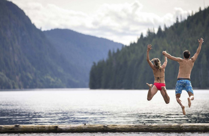 Jumping in lake at Sonora Resort and Conference Centre, Canada.