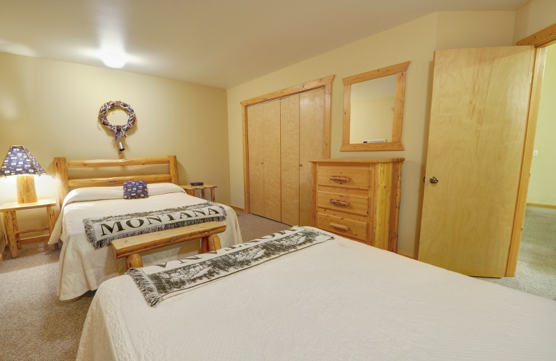 One of the bedrooms in our 2 bedroom cabin. Our 2 bedroom cabin can actually sleep 10 guests comfortably.  There are two queen beds in each room with an additional pullout queen in the living room. Located just 1/2 mile from Glacier National Park