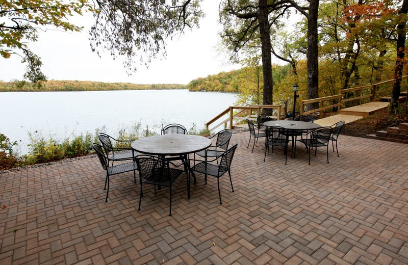 Patio with table and chairs by the lake at East Silent Resort.