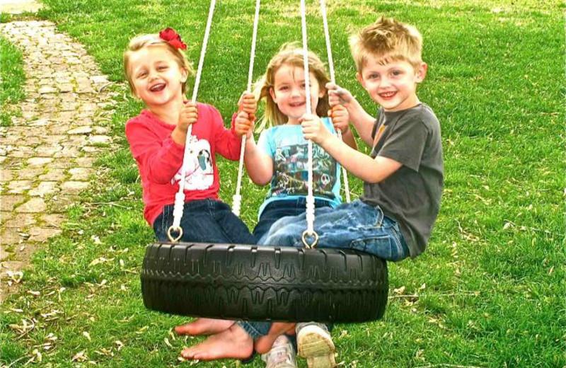 Children swinging at Sunset Inn Resort.