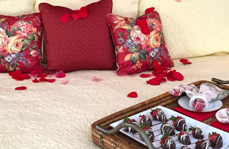 Chocolates on bed at Birchwood Inn.