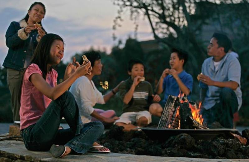 Family enjoying a bonfire at Newport Coast Villas.