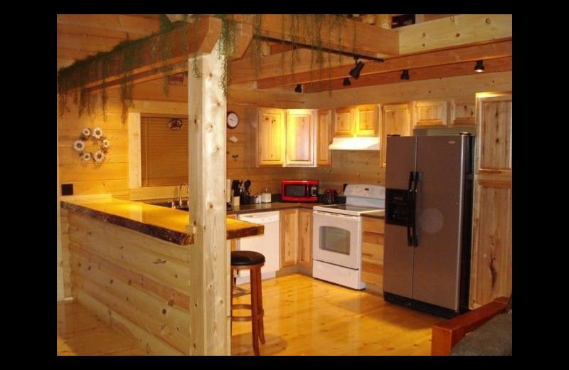 Cabin kitchen at Pine Ridge Log Cabins.