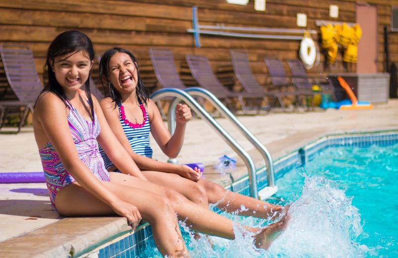 Kids by pool at Ruttger's Bay Lake Lodge.