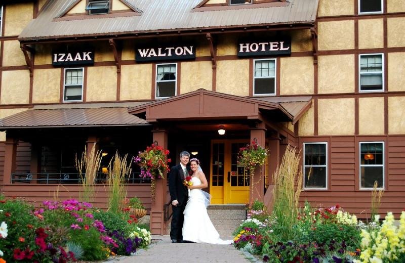 Wedding couple in front of Izaak Walton Inn.