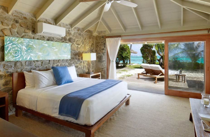 Cottage bedroom at Petit St Vincent Resort.