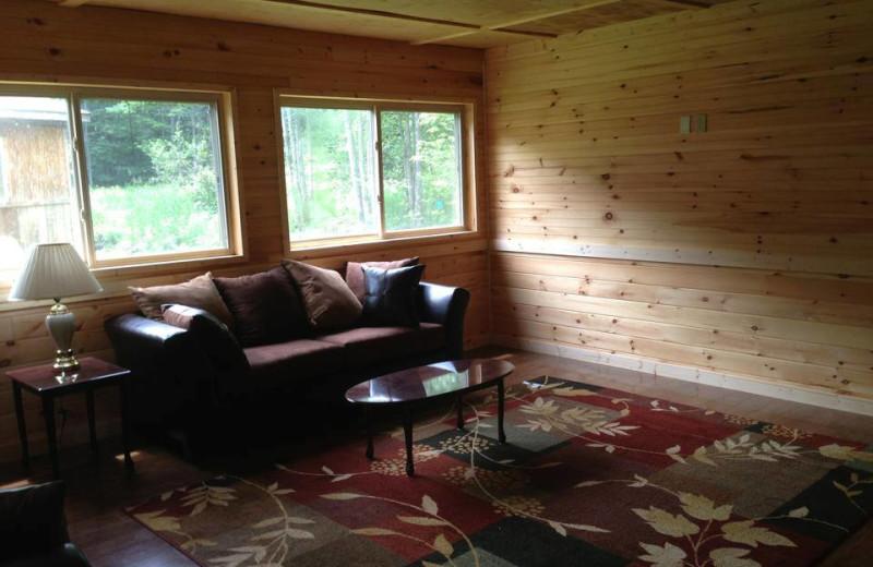 Cabin living room at The Woods At Bear Creek Glamping Resort.